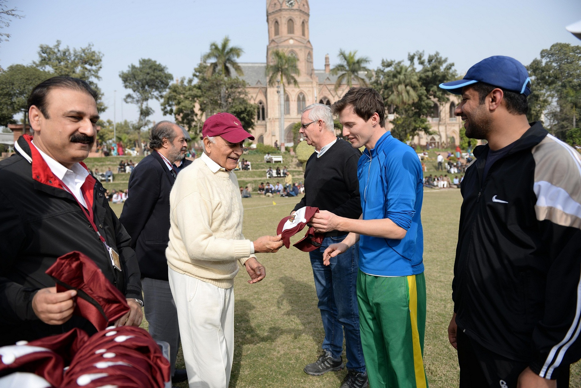 Mr. Parvez Masud giving cap to Mr. french captain of British High Commission team